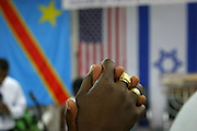 Israel, Tel Aviv, Members of the Christian Africans community are joint together for a prayer at their church in south Tel Aviv.
