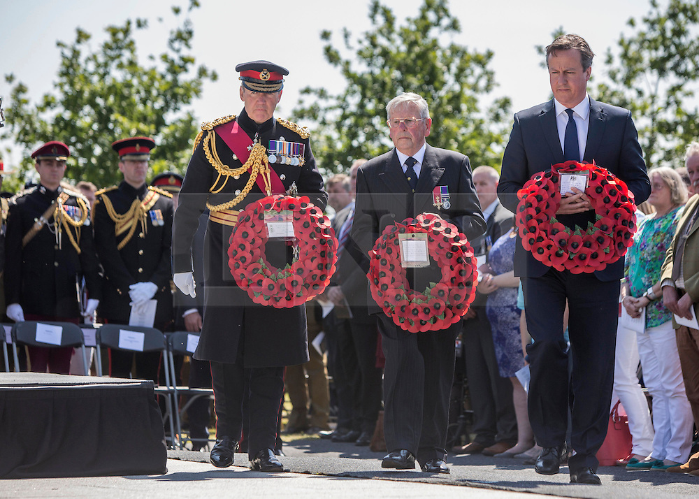 © Licensed to London News Pictures. 10/06/2015. Alrewas, UK. The Chief of the Defence Staff General Sir Nicholas Houghton and Mr Peter Andrews, father of Flight Sergeant Gary Andrews, killed in Afghanistan joined Prime Minister David Cameron as they laid a wreath at a Service of Dedication to inaugurate the Bastion Memorial, for those who lost their lives during combat operations in Afghanistan.  Over 2000 guests attended the ceremony.   Photo credit : Alison Baskerville/LNP