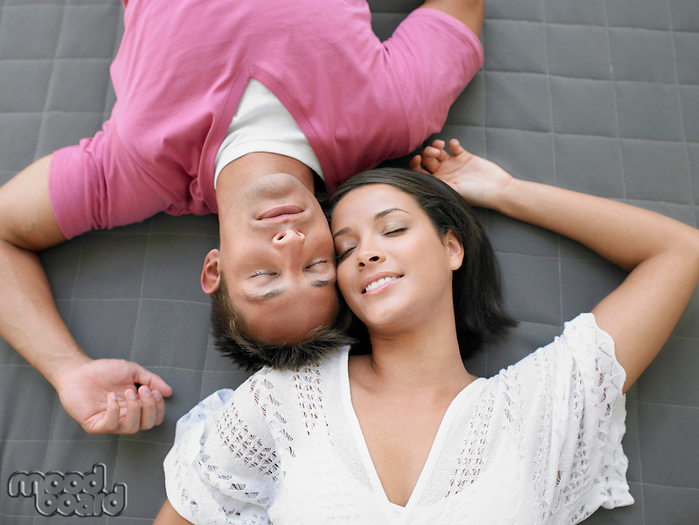 Affectionate Young Couple Lying Down