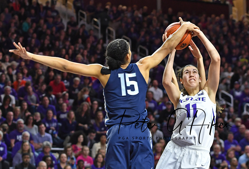 Guard Gabby Williams #15 of the Connecticut Huskies blocks the shot of forward Peyton Williams #11 of the Kansas State Wildcats during the second half at Bramlage Coliseum in Manhattan, Kansas.