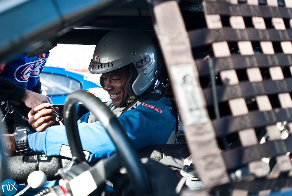 Jacquian Williams, a linebacker for the University of South Florida football team, prepares to take a ride-along from the Richard Petty Driving Experience at Charlotte Motor Speedway Wednesday afternoon. USF will play Clemson in the Meineke Car Care Bowl at Bank of America Stadium Friday at noon.(Photo by James Nix)