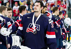 Connor Hellebuyck of USA with bronze medal after winning during Ice Hockey match between USA and Czech Republic at Third place game of 2015 IIHF World Championship, on May 17, 2015 in O2 Arena, Prague, Czech Republic. Photo by Vid Ponikvar / Sportida
