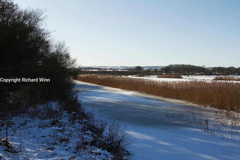 The channel near the hide on Noah's Lake at Shapwick Heath following heavy snow and freezing conditions.