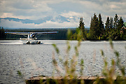 Beaver float plane of Tweedsmuir Air Services, lands at Nimpo Lake, BC.