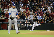 Jul 10, 2013; Phoenix, AZ, USA;  Arizona Diamondbacks infielder Aaron Hill (2) hits a solo home run against the Los Angeles Dodgers pitcher Hyun-Jin Ryu (99) in the first inning at Chase Field. Mandatory Credit: Jennifer Stewart-USA TODAY Sports