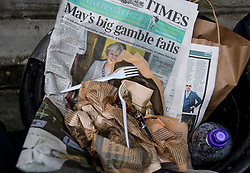 © Licensed to London News Pictures. 09/06/2017. London, UK. A newspaper showing a front page story about the election performance of British prime minister  THERESA MAY lies in a bin on Downing Street. Photo credit: Ben Cawthra/LNP