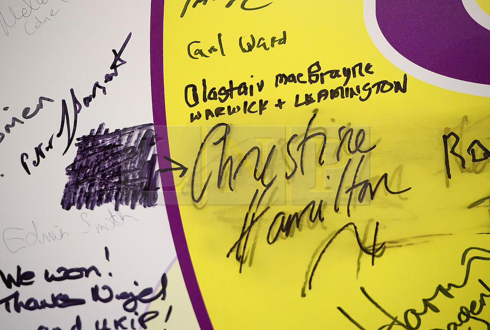 """©  London News Pictures. 17/09/2016. Bournemouth, UK. The words """"Bent Tory crooks"""" rubbed out next to Christine Hamiltons name on a signed UKIP board at the expo stands at Day 2 of the 2016 UKIP Autumn Conference, at the Bournemouth International Centre in Bournemouth, Dorset. On Friday, the party elected Diane James as their new leader, following Nigel Farage resignation after the UK voted to leave the EU in a referendum..  Photo credit: Ben Cawthra/LNP"""