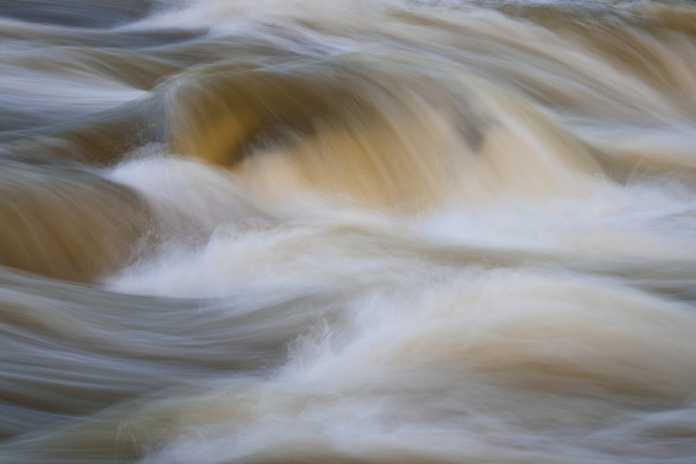 Abstract of silt-ladden winter rapids on the Potomac River just above the Great Falls, Great Falls National Park, Great Falls, Virginia