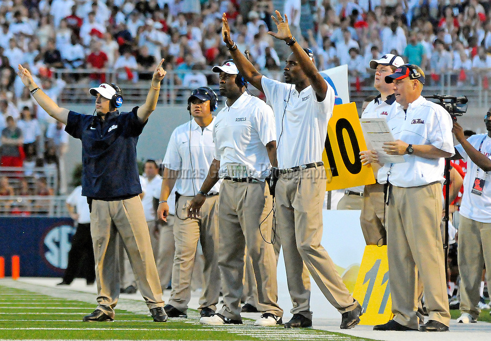 Mississippi coaches signal during the first half of an NCAA college football game against Central Arkansas in Oxford, Miss., Saturday, Sept. 1, 2012. (Photo/Thomas Graning)