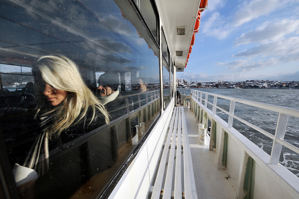 Istanbul, Turkey 18 February 2008 <br /> View of a woman inside a passengers boat crossing the Bosphorus strait. <br /> Istanbul, historically Byzantium and later Constantinople, is Turkey's most populous city and its cultural and financial center.<br /> Photo: Ezequiel Scagnetti