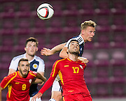 Scotland's Stephen Kingsley beats FYR Macedonia's Kire Markoski in th air during Scotland Under-21 v FYR Macedonia,  UEFA Under 21 championship qualifier  at Tynecastle, Edinburgh. Photo: David Young<br /> <br />  - © David Young - www.davidyoungphoto.co.uk - email: davidyoungphoto@gmail.com