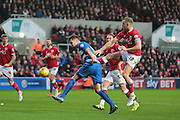 Bristol City forward Aaron Wilbraham and Queens Park Rangers defender Grant Hall during the Sky Bet Championship match between Bristol City and Queens Park Rangers at Ashton Gate, Bristol, England on 19 December 2015. Photo by Jemma Phillips.