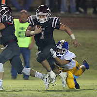 Lauren Wood | Buy at photos.djournal.com<br /> Kossuth's Jaley Adams runs the ball as Booneville's Adam Baggett reaches for the tackle during Friday night's game at Kossuth.