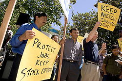 Palo Alto, CALIF. June 24, 2004-Tech workers including Devendar Methuku, L,  and Martin Silver (far right)-rally in opposition to stock option regulations outside Palo Alto City Hall, June 24, 2004 Photo by Kim Kulish
