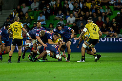 March 30, 2018 - Melbourne, VIC, U.S. - MELBOURNE, AUSTRALIA - MARCH 30 : Amanaki Mafi of the Melbourne Rebels  is tackled by  Sam Lousi of the Wellington Hurricanes during Round 7 of the Super Rugby Series between the Melbourne Rebels and the Wellington Hurricanes on March 30, 2018, at AAMI Park in Melbourne, Australia. (Photo by Jason Heidrich/Icon Sportswire) (Credit Image: © Jason Heidrich/Icon SMI via ZUMA Press)