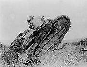 World War I 1914-1918: Tank ploughing its way through a trench and making towards the German line near Saint Michel, France.   War Machine Armoured Vehicle Caterpillar Track