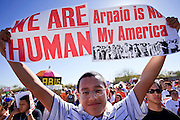 Feb. 28, 2009 -- PHOENIX, AZ: A Mexican-American teen holds up signs protesting Maricopa County Sheriff Joe Arpaio's immigration policies. Thousands of people in Phoenix, AZ, protested against Maricopa County Sheriff Joe Arpaio's immigration policies. Arpaio has polarized the community by conducting raids against illegal immigrants in businesses and neighborhoods in the Phoenix area that are frequented by Hispanics. Members of Congress have written to Attorney General Eric Holder and asked him to investigate Arpaio for human rights violations. Arpaio claims he has authority under the Department of Homeland Security's 287g program to investigate and arrest illegal immigrants.     Photo By Jack Kurtz