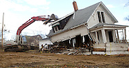 Workers with Kelly Demolition tear down a house in the Czech Village area of Cedar Rapids, Iowa on Thursday, November 11, 2010.
