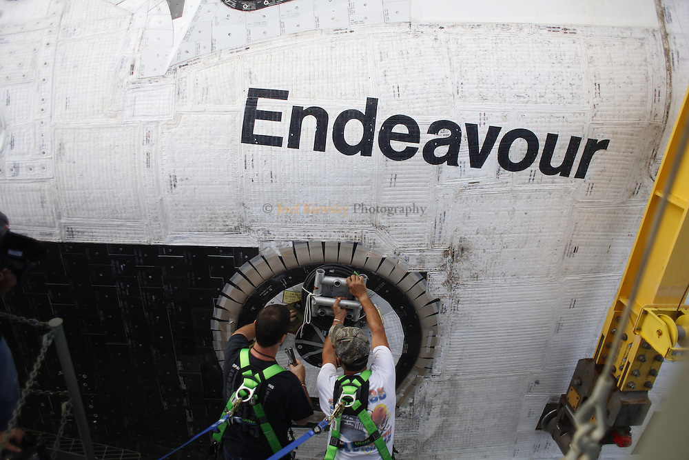 Cape Canaveral, Florida US - The space shuttle Endeavour is prepared for her final ferry flight atop the Shuttle Carrier Aircraft, a modified 747.