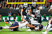Josh Jacobs (RB) of the Oakland Raiders is tackled by Roy Robertson-Harris (DE) of the Chicago Bears during the International Series match between Oakland Raiders and Chicago Bears at Tottenham Hotspur Stadium, London, United Kingdom on 6 October 2019.