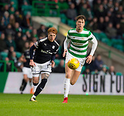 4th April 2018, Celtic Park, Glasgow, Scotland; Scottish Premier League football, Celtic versus Dundee; Jack Hendry of Celtic races away from Simon Murray of Dundee