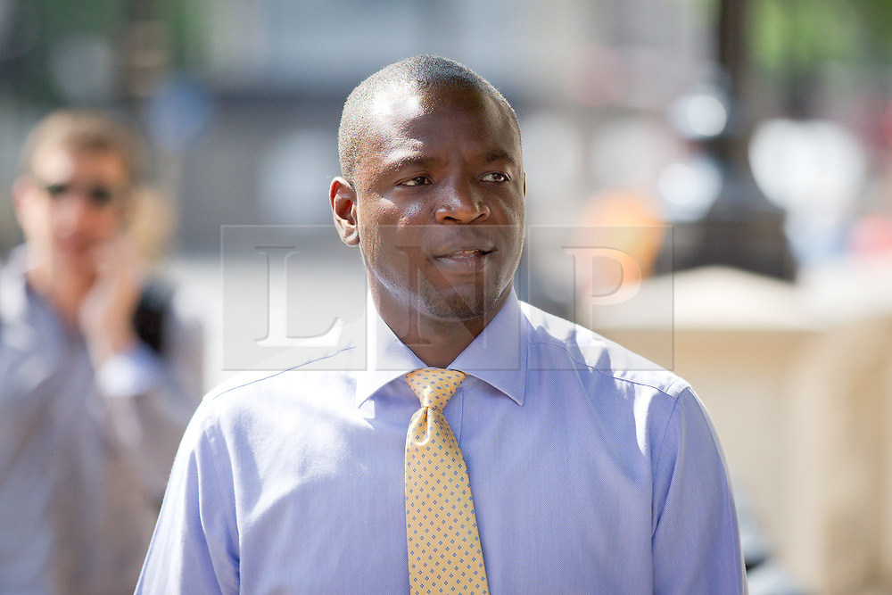 © Licensed to London News Pictures. 05/07/2013. London, UK. Duwayne Brooks, friend of murder victim Stephen Lawrence, arrives on Whitehall in London today (05/07/2013) for a meeting with Nick Clegg, the British Deputy Prime Minister, over allegations that the Metropolitan Police Service bugged meetings between themselves, Brooks and his lawyers in an effort to smear the Lawrence family and their friends. Photo credit: Matt Cetti-Roberts/LNP