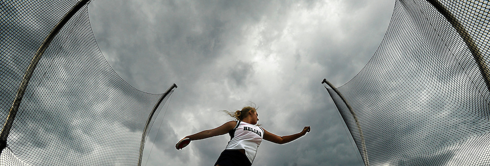Helias's Jessika Twehous competes in the girls discus event under threatening skies during a track and field meet against Jefferson City at Adkins Stadium.