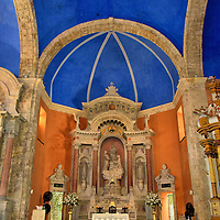 Altar of Iglesia de Santo Domingo in Old Town, Cartagena, Colombia<br /> When Pedro de Heredia founded the city in 1533, part of his entourage were Dominican friars. Their first simple monastery was built during the early 16th century.  It was destroyed by fire in 1552.  Today's Plaza de Santo Domingo was selected for the church's replacement.  Construction dragged on until the end of the 17th century.  The exterior of Iglesia de Santo Domingo is rather plain.  However, inside is this beautiful marble altarpiece beneath the nave's 33 foot blue ceiling.
