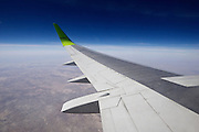 Uzbekistan. Flying along the silk road aboard an Air Baltic Boeing 737 jet plane.