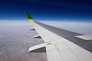 Uzbekistan. Flying along the silk road aboard an Air Baltic Boeing 737 jet plane.