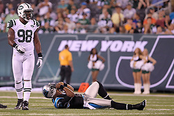 Aug 26, 2012; East Rutherford, NJ, USA; New York Jets defensive end Quinton Coples (98) walks away after hitting Carolina Panthers quarterback Cam Newton (1) during the first half at MetLife Stadium.