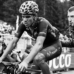 Andrey Amador welcomed some help at the end of a tough stage in the Dolomites.