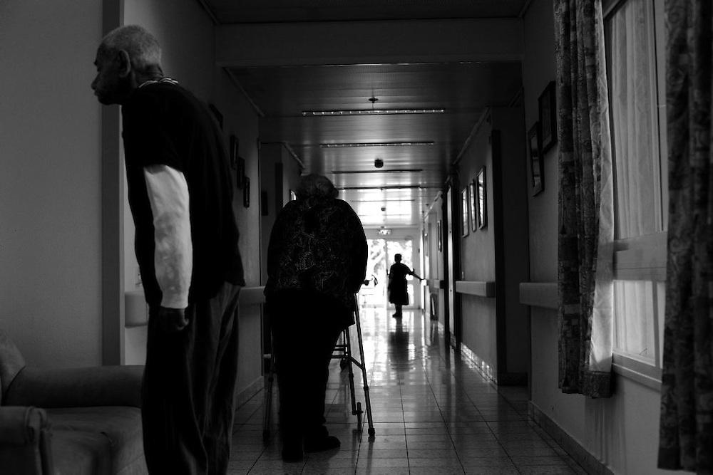 Holocaust survivor walk through a corridor in the Shaar Menashe Mental Health Center for Holocaust survivors in Pardes Hanna, Israel on Nov 2, 2010.