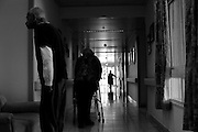 Holocaust survivor walk through a corridor in the Shaar Menashe Mental Health Center for Holocaust survivors in Pardes Hanna, Israel on Nov 2, 2010.