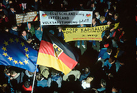 December 1989, Leipzig, East Germany --- People celebrate at a rally in Leipzig just after the fall of communism in East Germany. --- Image by © Owen Franken/CORBIS