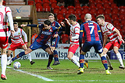 Bradford City midfielder Alex Gilliead shoots at goal in a congested box during the EFL Sky Bet League 1 match between Doncaster Rovers and Bradford City at the Keepmoat Stadium, Doncaster, England on 19 March 2018. Picture by Aaron  Lupton.