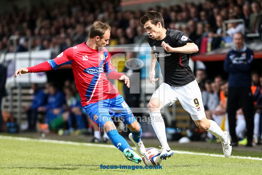 John Marquis of Northampton Town (right) takes on Scott Doe of Dagenham &amp; Redbridge during the Sky Bet League 2 match at the London Borough of Barking and Dagenham Stadium, London<br /> Picture by Andy Kearns/Focus Images Ltd 0781 864 4264<br /> 26/04/2014