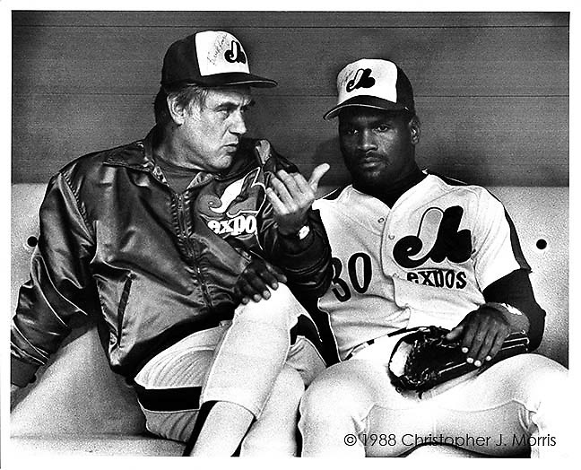 Montreal Expos Manager, Buck Rodgers, and Expos outfielder, Tim Raines sitting in the dugout before a game in Montreal's Olympic Stadium.