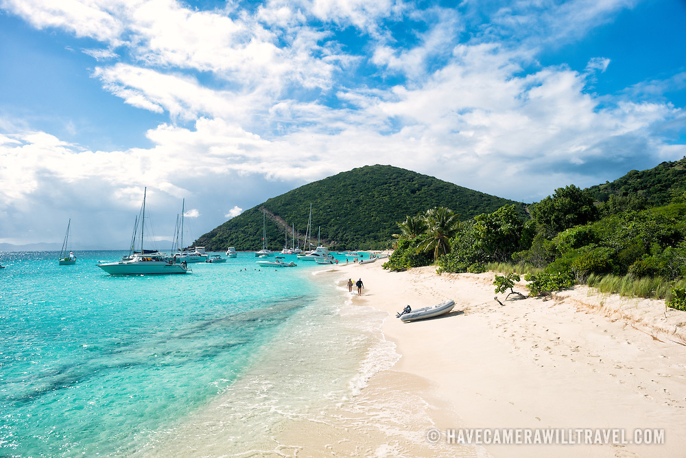 Looking south along the sandy beach at White Bay on Jost Van Dyke in the British Virgin Islands. The beach is famous for a string of bars serving tropical drinks, most famously the Soggy Dollar Bar.