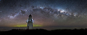 22x55 inch panoramic print.  A faint Aurora glows behind the Waipapa Point Lighthouse, as the Milky Way arcs overhead.  Catlins, South Island, New Zealand.  September 2nd, 2013.