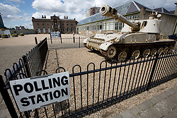 © Licensed to London News Pictures. 07/05/2015.  An old tank sits outside a polling station in Woolwich, se London on General Election day. Credit : Rob Powell/LNP