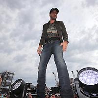 Country music superstar Luke Bryan performs before the 56th Annual NASCAR Daytona 500 practice session at Daytona International Speedway on Saturday, February 22, 2014 in Daytona Beach, Florida.  (AP Photo/Alex Menendez)