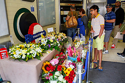 © Licensed to London News Pictures. 07/07/2015. London, UK. Members of the public pay their respects to 7/7 London bombings victims on the 10th anniversary of 7/7 London bombings at Russell Square Tube Station on Tuesday, July 7, 2015. Photo credit: Tolga Akmen/LNP