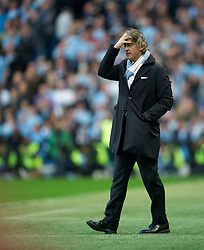 MANCHESTER, ENGLAND - Monday, April 30, 2012: Manchester City's manager Roberto Mancini during the Premiership match against Manchester United at the City of Manchester Stadium. (Pic by David Rawcliffe/Propaganda)