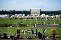 © Licensed to London News Pictures. 21/06/2018. London, UK. The cleanup begins at the end of Ladies Day at Royal Ascot at Ascot racecourse in Berkshire, on June 21, 2018. The 5 day showcase event, which is one of the highlights of the racing calendar, has been held at the famous Berkshire course since 1711 and tradition is a hallmark of the meeting. Top hats and tails remain compulsory in parts of the course. Photo credit: Ben Cawthra/LNP