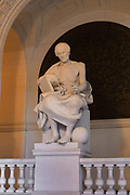 Statue of Archimedes by Alexandre Falguiere, 1831-1900, representing Sciences, in the Entrance Hall or Grand Vestibule, accessed from the Rue des Ecoles, in the Palais Academique at the Sorbonne, the main building of the University of Paris in the 5th arrondissement of Paris, France. The Palais Academique today houses the seat of the chancellery of the universities and the academy of Paris. Picture by Manuel Cohen