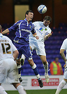 Stockport - Saturday October 31st 2009: Michael Raynes of Stockport County in action against Grant Holt of Norwich City during the Coca Cola League One match at Edgeley Park, Stockport. (Pic by Michael SedgwickFocus Images)