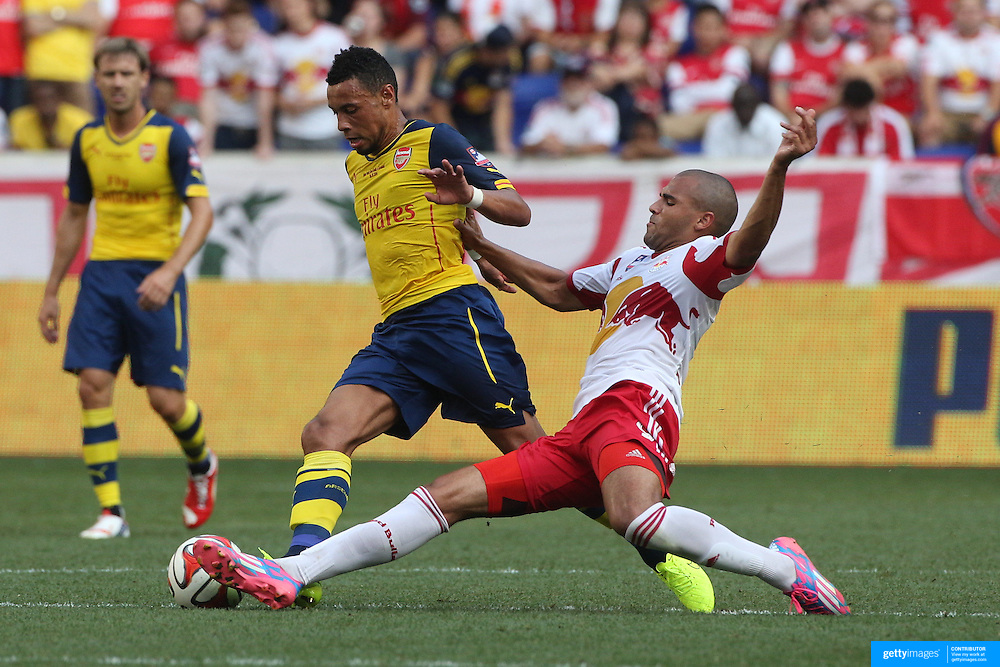 Francis Coquelin, (left), Arsenal, is challenged by Andre Akpan, New York Red Bulls, during the New York Red Bulls Vs Arsenal FC,  friendly football match for the New York Cup at Red Bull Arena, Harrison, New Jersey. USA. 26h July 2014. Photo Tim Clayton