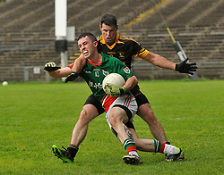 Lahardane's Barry Leonard closes down Kilmaine's Michael Hession during the County junior final. <br /> Pic Conor McKeown