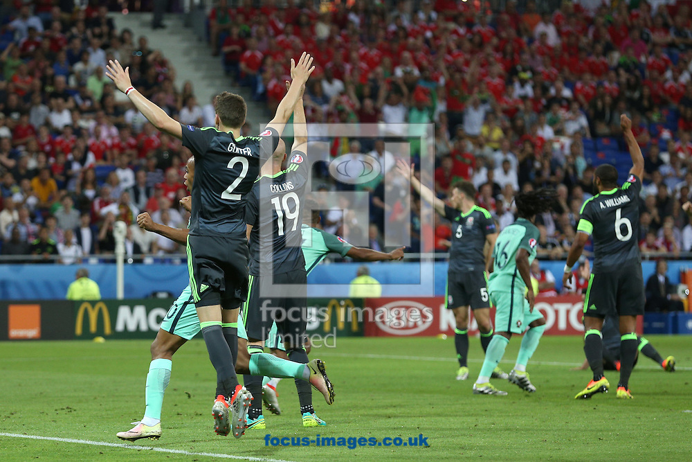 After Nani of Portugal scores his sides 2nd goal the Wales players appeal for offside to Referee Jonas Eriksson (Sweden) during the UEFA Euro 2016 semi-final match at Stade de Lyons, Lyons<br /> Picture by Paul Chesterton/Focus Images Ltd +44 7904 640267<br /> 06/07/2016